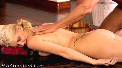 Превью фото Блондинка дрочит мужику промеж больших сисек на массаже